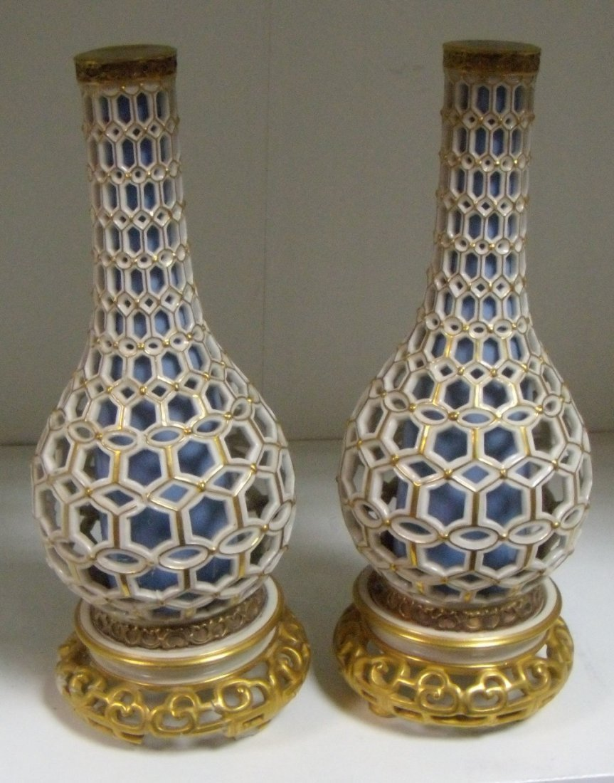 A matched pair of Royal Worcester reticulated bottle