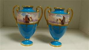 A pair of early 20th century Mintons two handled vases