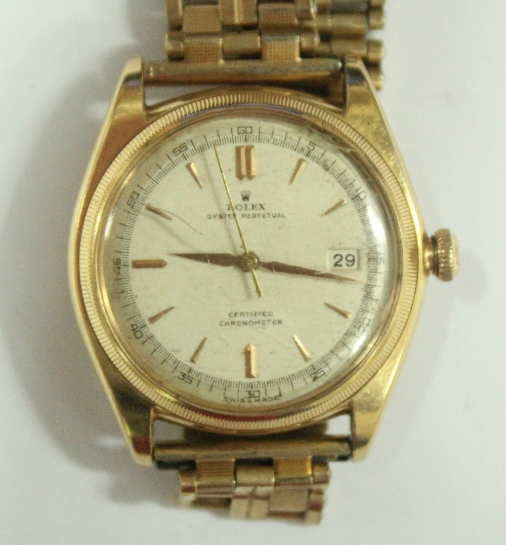 Rolex - a gentleman's gold oyster perpetual certified