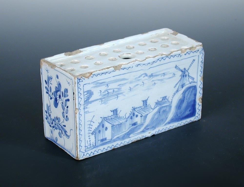 A mid 18th century Delft blue and white flower brick,