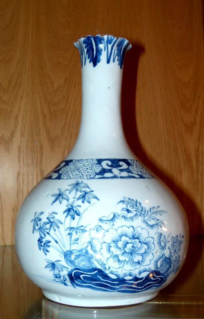 A mid 18th century Delft blue and white bottle vase,