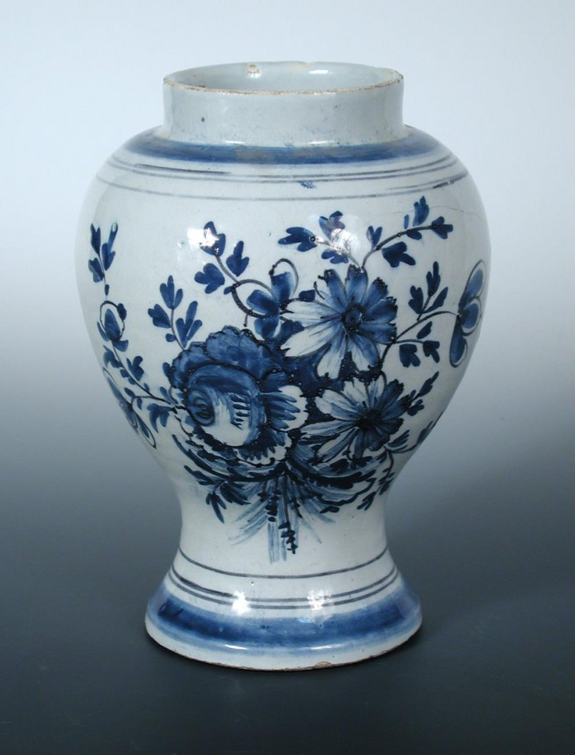 A mid 18th century Delft blue and white jar,