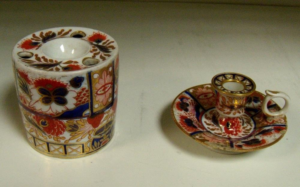 A Chamberlain's Worcester inkwell and a chamberstick,