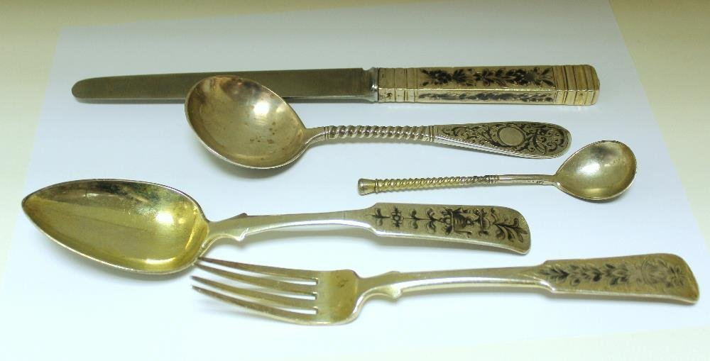 A matched 19th century Russian silver gilt five piece