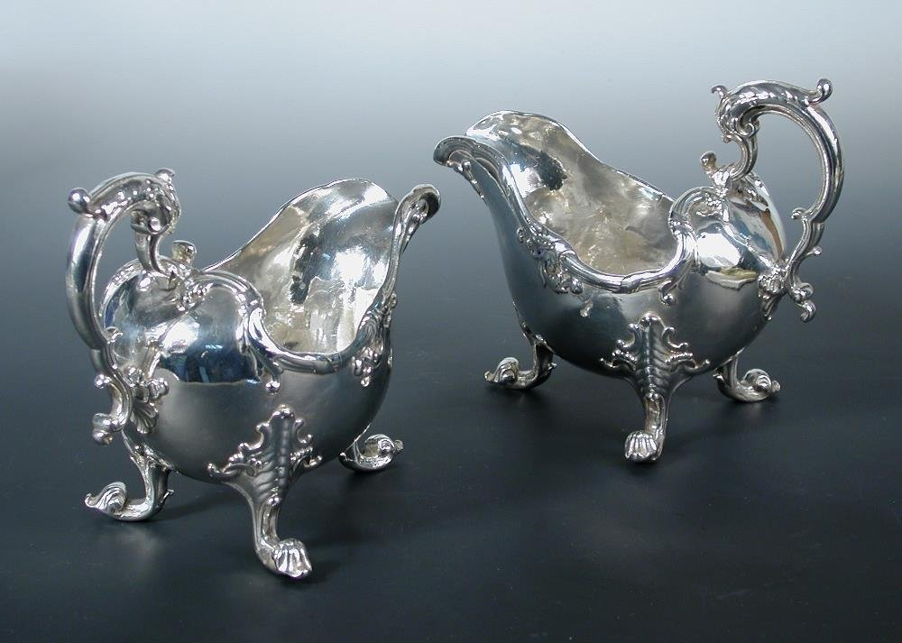 A pair of George II silver sauceboats,