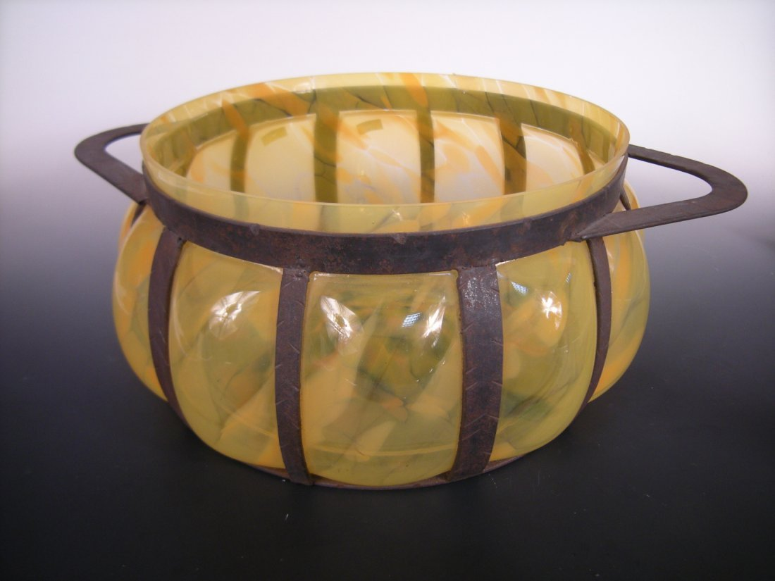 A large Murano glass lobbed bowl within wrought iron