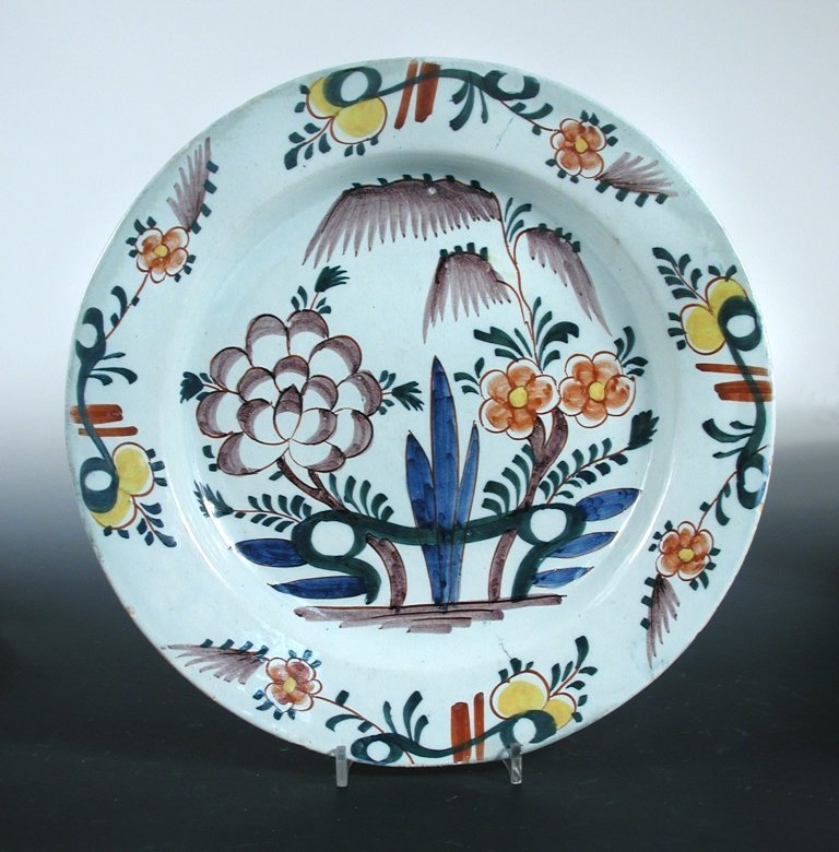 Two mid 18th century large Delft dishes and a blue and