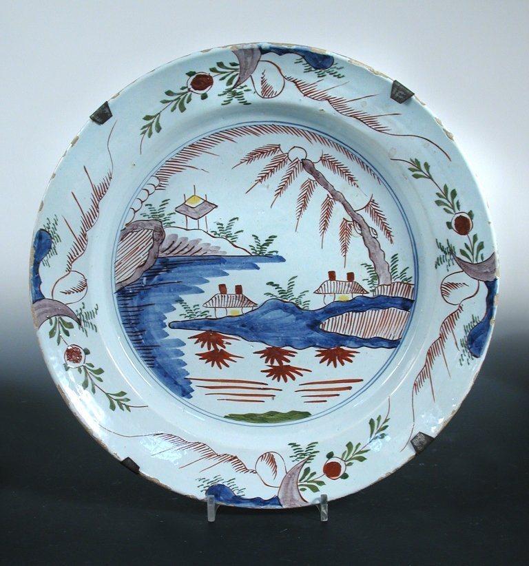 Four 18th century polychrome Delft plates and a dish,