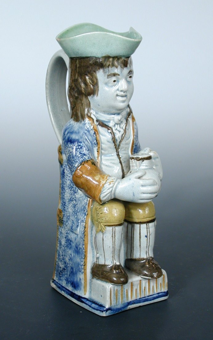 A late 18th century Ralph Wood type pearlware toby jug,
