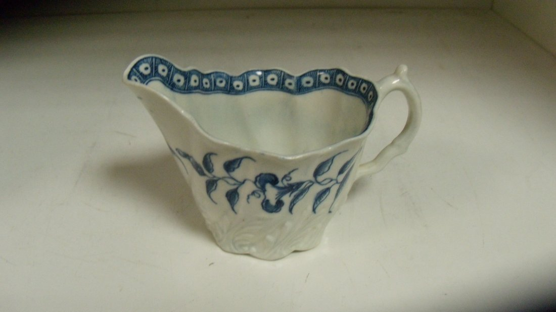 An 18th century Worcester blue and white cream jug,