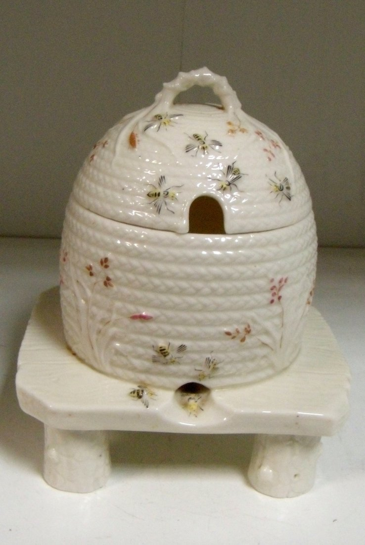 A 'First Period' Belleek honey pot and cover,