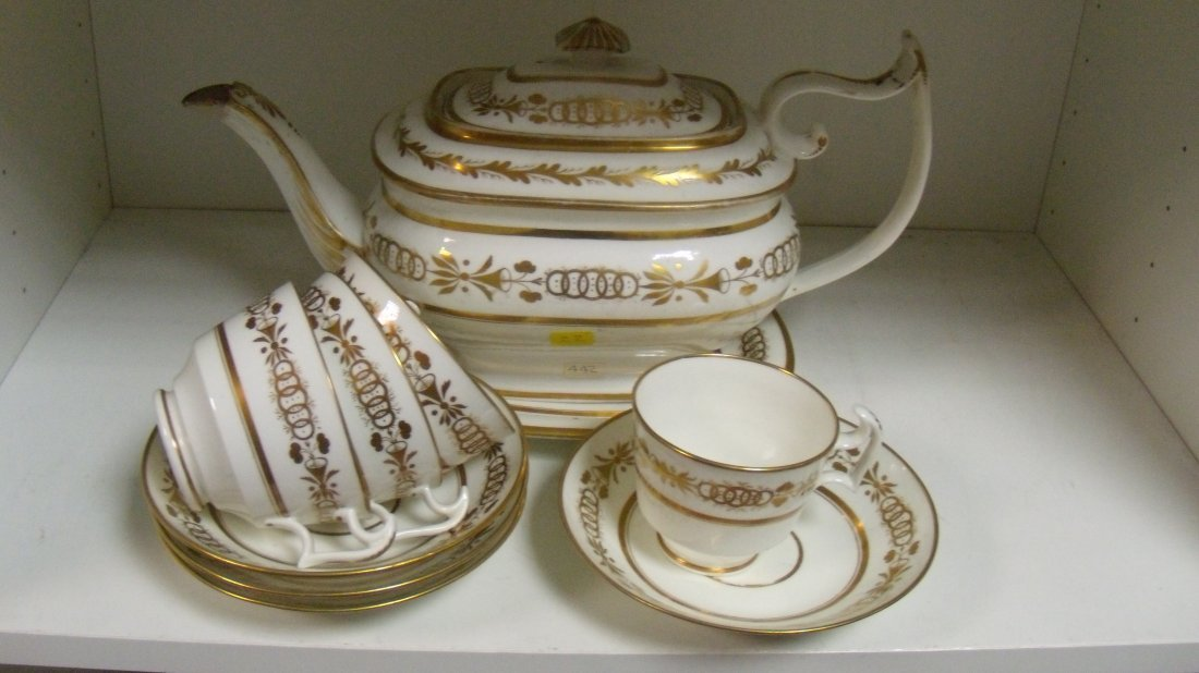 Four Swansea cups, four saucers, a teapot, cover and