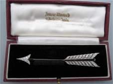 A French art deco platinum diamond and onyx jabot pin
