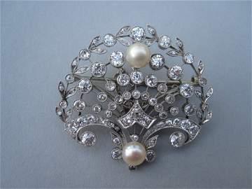 A belle époque diamond and pearl brooch / pendant,