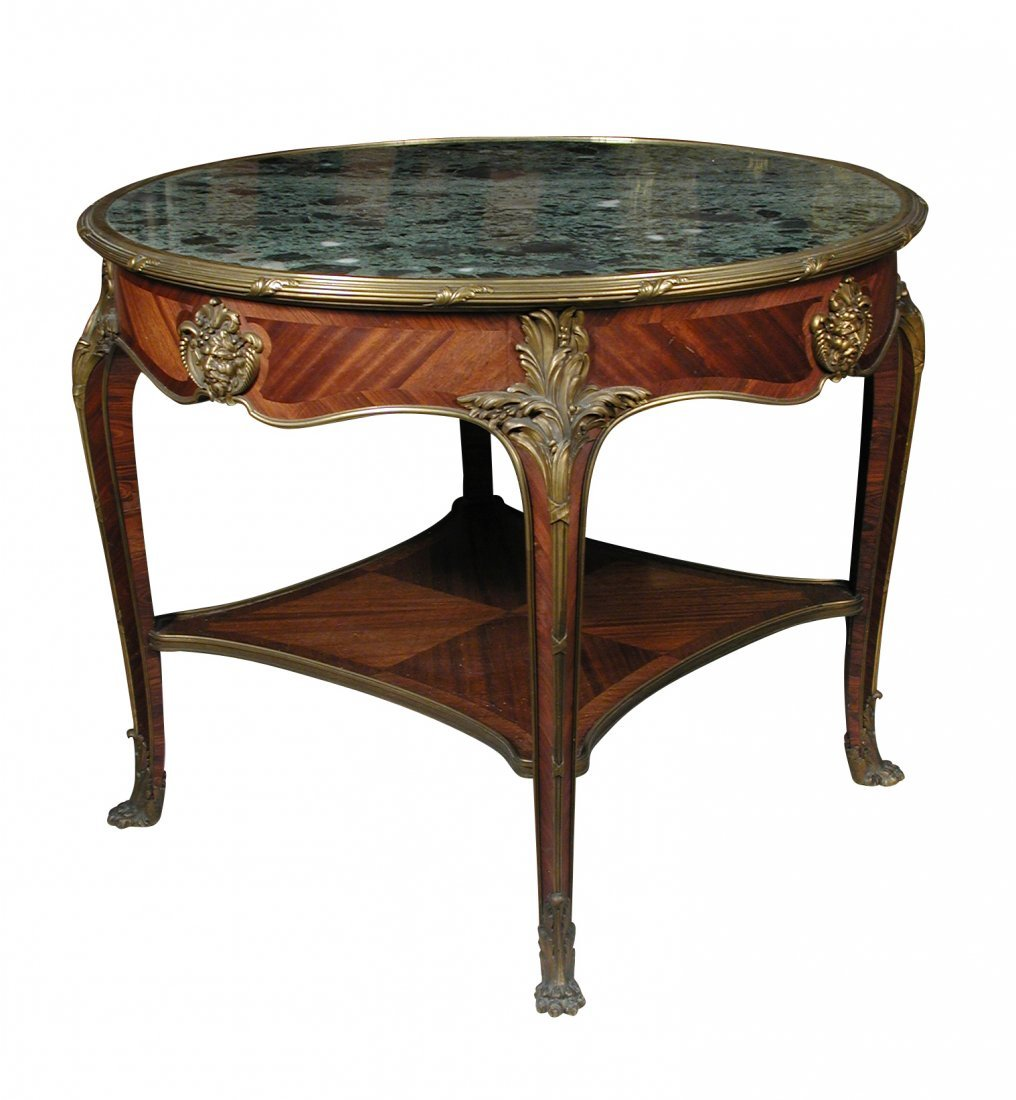 A French ormolu mounted kingwood centre table, circa