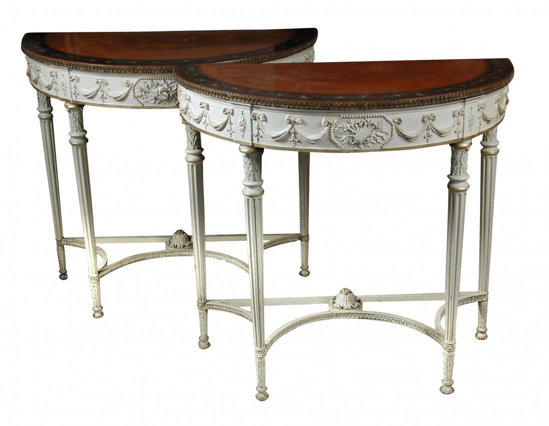 A pair of demi-lune satinwood console tables, circa