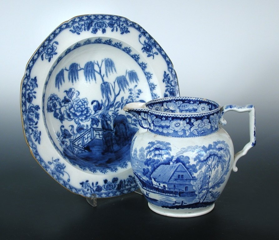 Twelve Cambrian Pottery blue and white plates and a