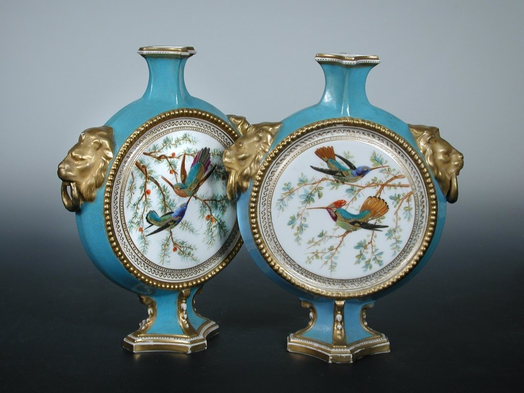 A pair of mid Victorian Derby Crown Porcelain moon