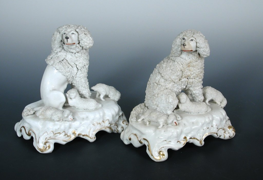 Two similar early Victorian Staffordshire poodle and