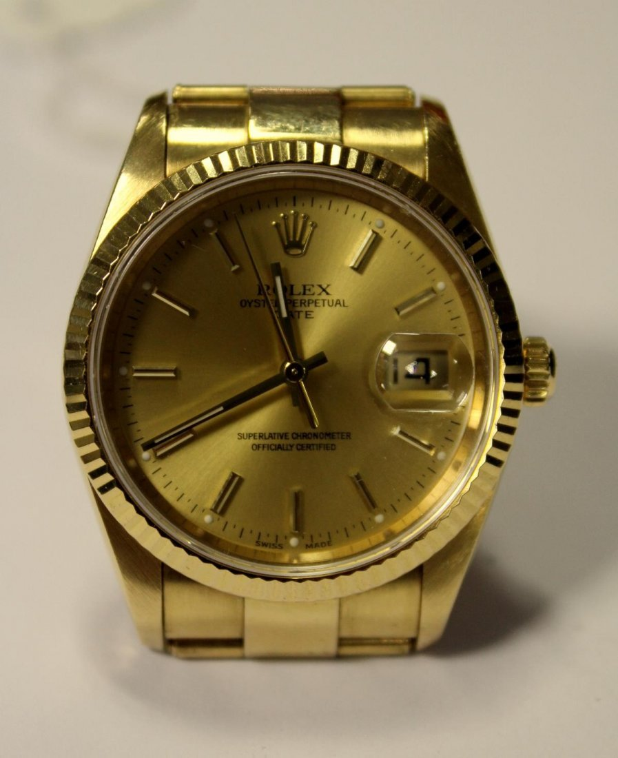 A gentleman's 18ct gold Rolex Oyster Perpetual Date