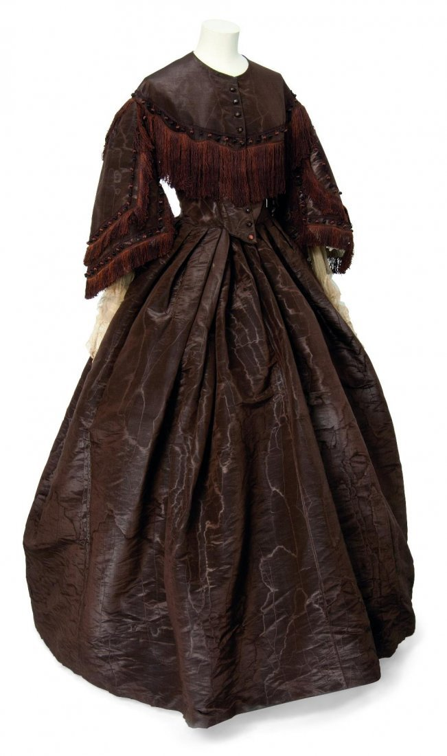Four lady's dresses - of chocolate silk; a fawn capelet;