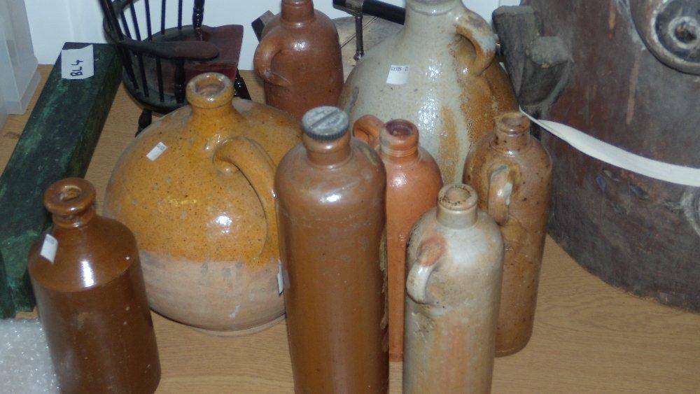 A Bellarmine and seven stoneware bottles,
