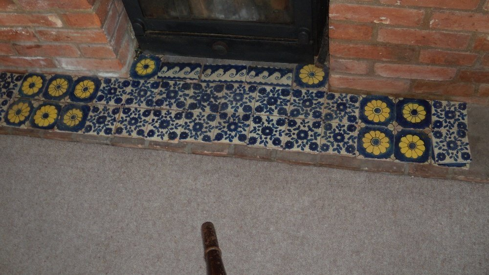 A collection of thirty six floral tiles