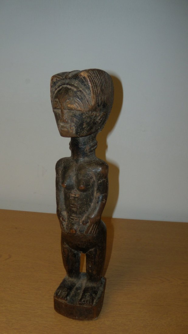 A 1920's Baule carved wood figure of a lady,