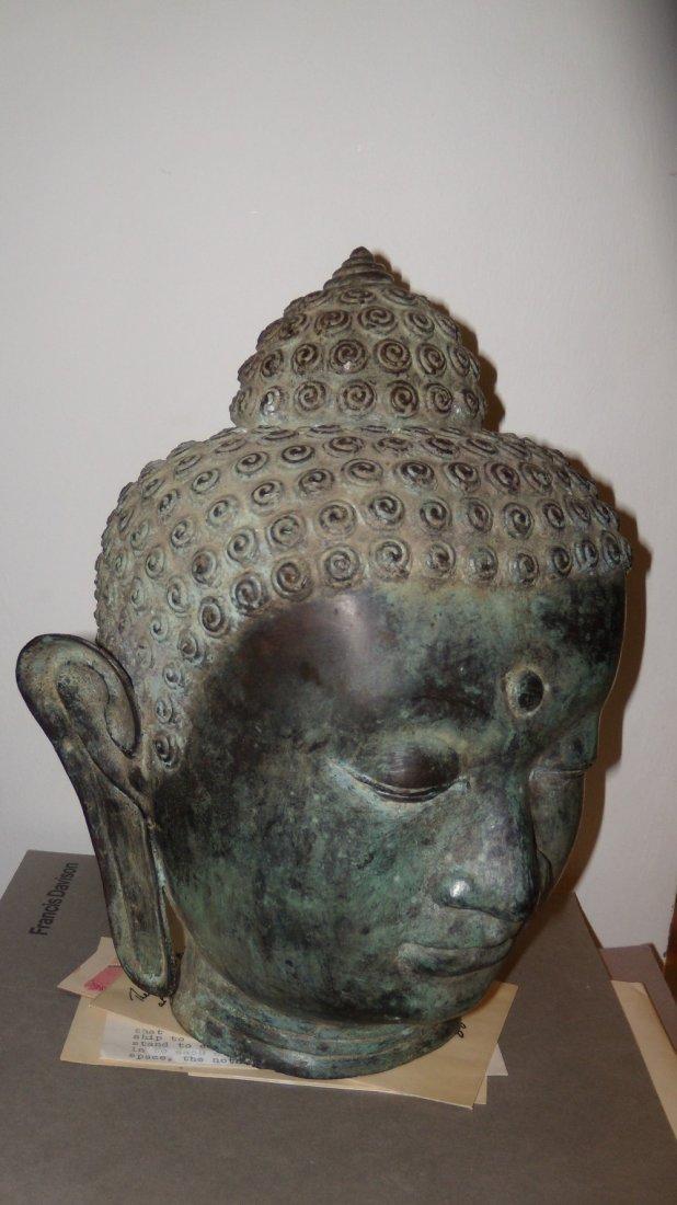 A 19th century Sino Indian bronze head of the Buddha,