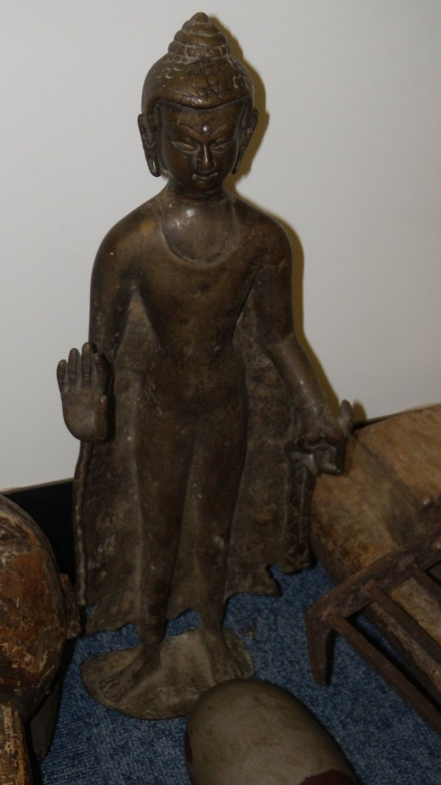 A 19th century Thai or Burmese bronze standing Buddha,
