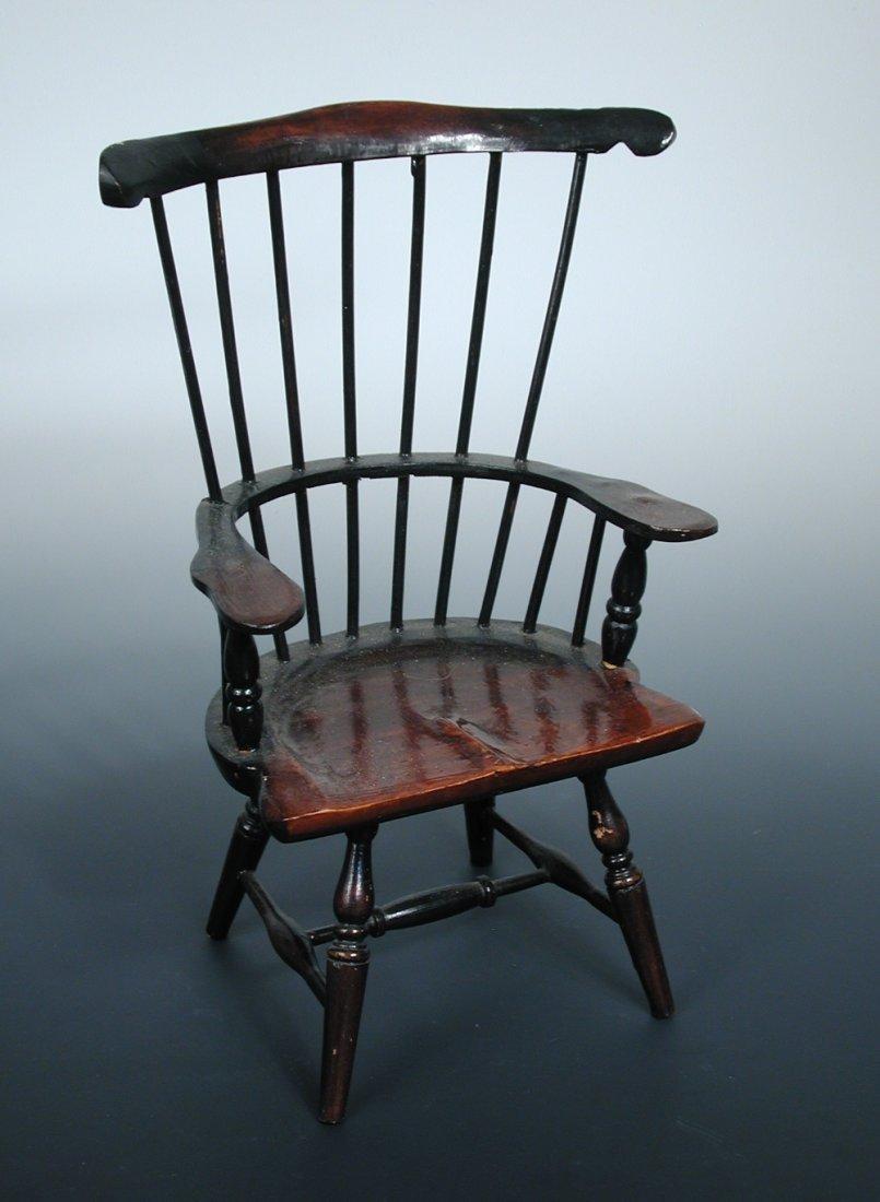 A 20th century miniature rake backed chair,