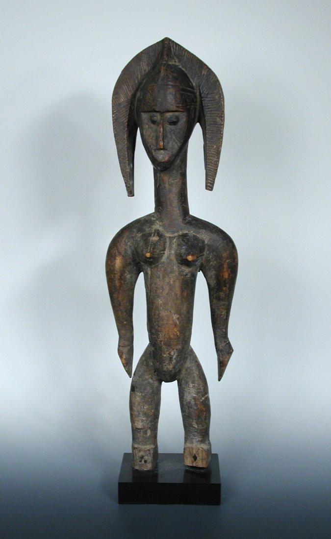 A Bamana carved wood figure of a lady, 1012,