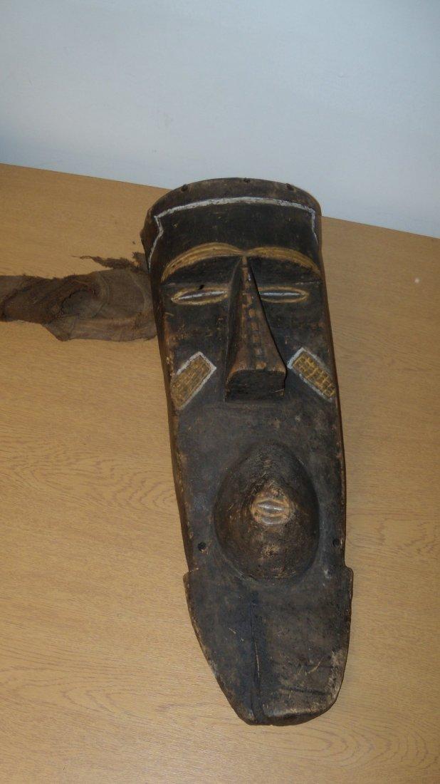 A Bashongo wooden mask, 1049,