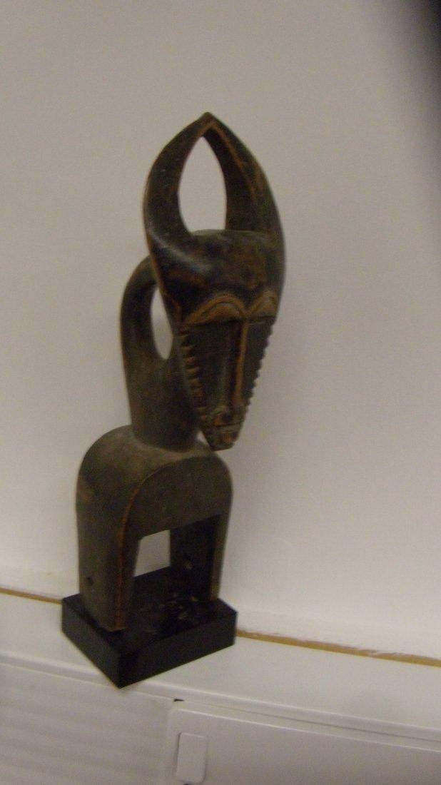 A Baule wood figural pulley,