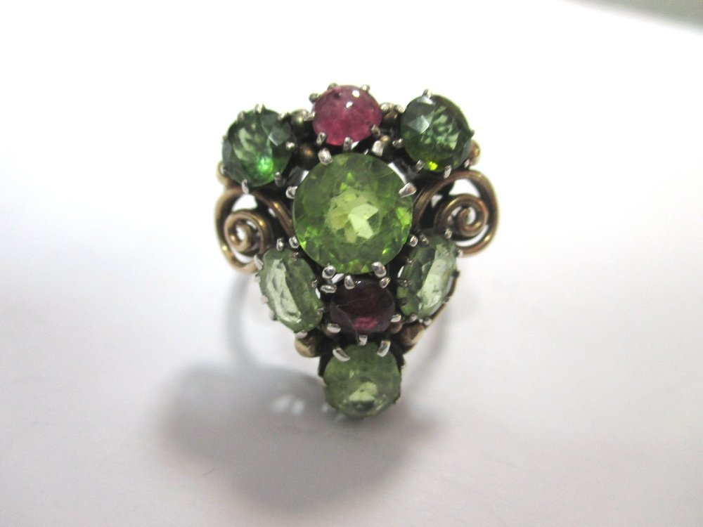 A peridot and ruby ring attributed to Dorrie Nossiter,