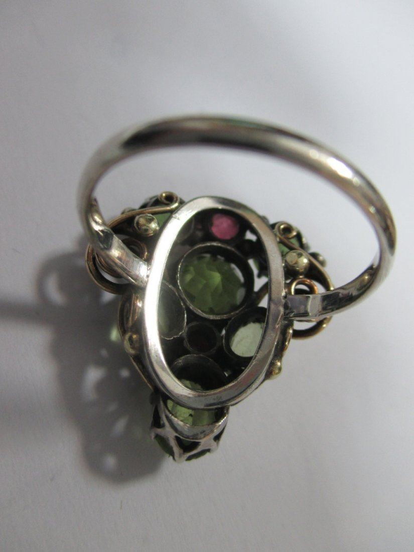 A peridot and ruby ring attributed to Dorrie Nossiter, - 2