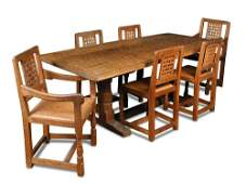 A Robert Mouseman Thompson oak table and six chairs