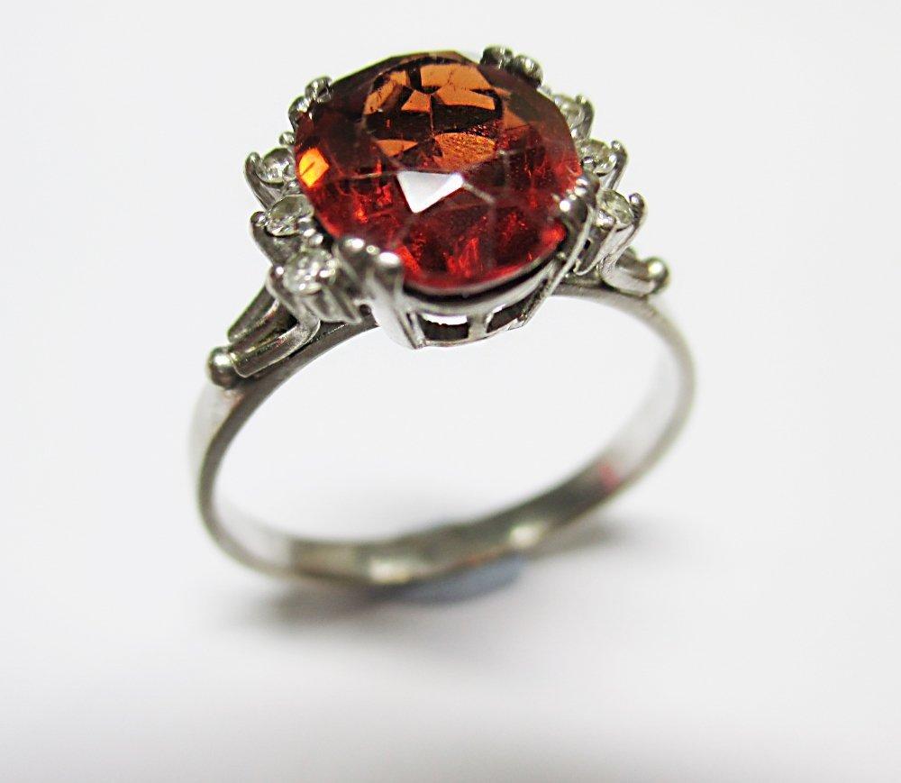 A spessartine garnet and diamond ring,