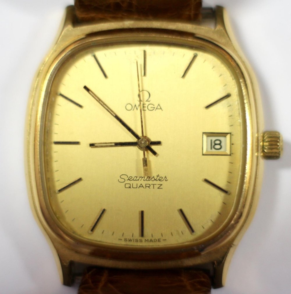 By Omega - a 'Seamaster' gold plated quartz wristwatch,