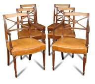 A set of six Regency style mahogany leather seat dining