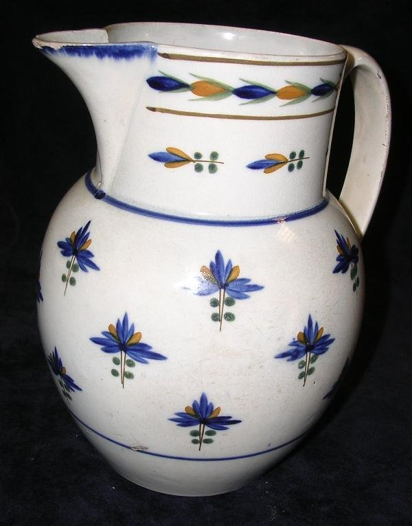 13: A late 18th century creamware jug