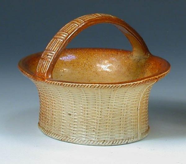 14: A late Victorian brown saltglaze basket