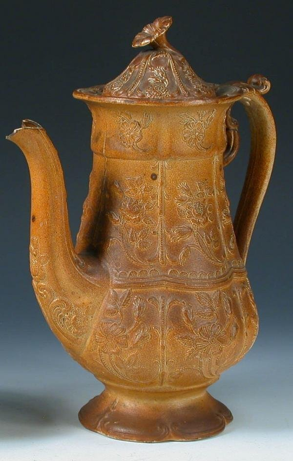 16: A mid 19th century brown saltglaze coffee pot
