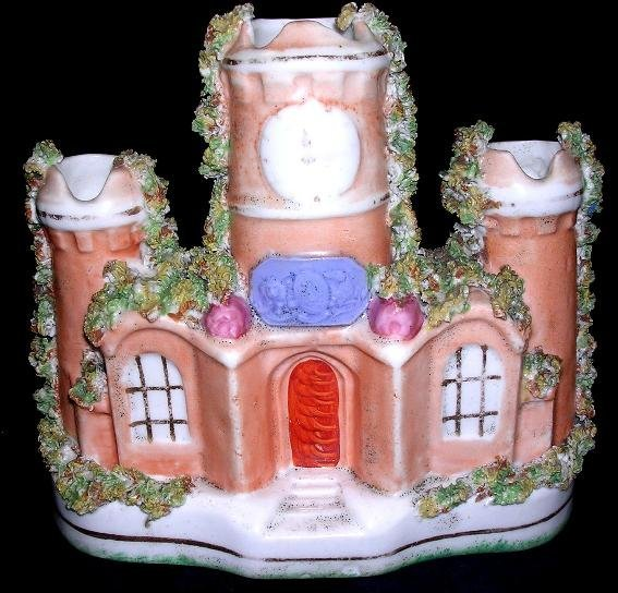 21: A mid 19th century Staffordshire castle spill vase