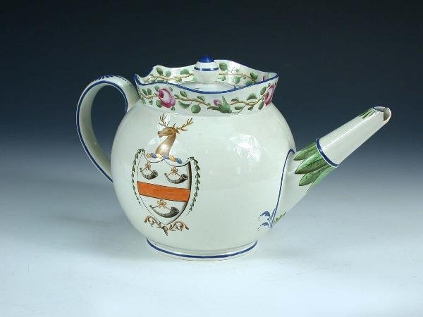 3: An early 19th century pearlware armorial teapot