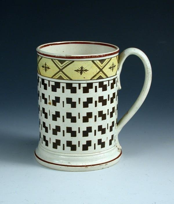 7: A late 18th century creamware mug