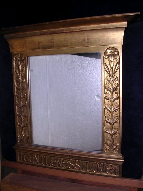616: An Arts and Crafts giltwood mirror
