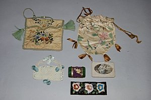 1002: A small group of bags and accessories, including: