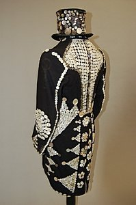 4: A pearly King outfit, circa 1910, comprising top hat