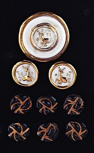 22: A moulded glass brooch and matching ear-rings, prob